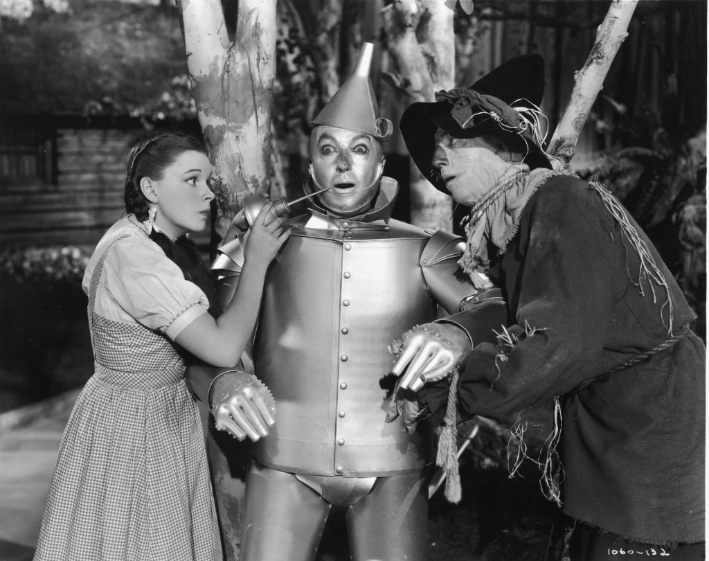(L-R) Judy Garland as Dorothy, Jack Haley as the Tin Man, and Ray Bolger as Scarecrow
