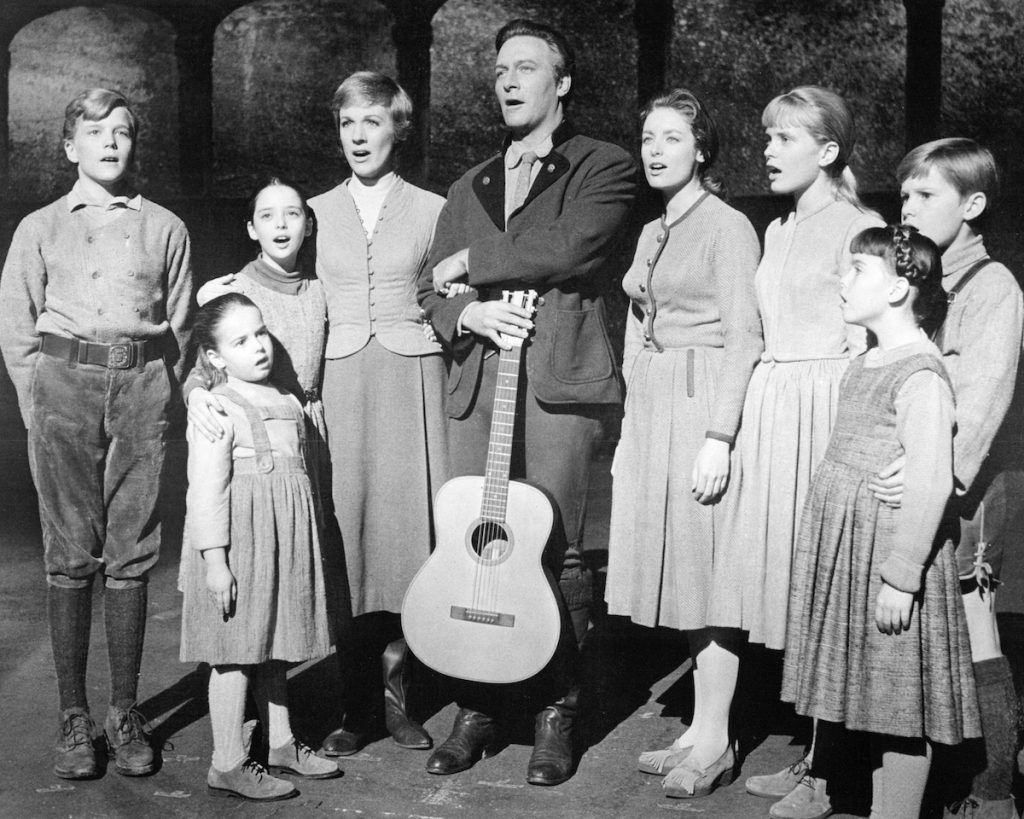 The actors playing members of the Von Trapp family in a promotional portrait for 'The Sound Of Music', directed by Robert Wise, 1965. Left to right: Nicholas Hammond as Friedrich, Kym Karath as Gretl, Angela Cartwright as Brigitta, Julie Andrews as Maria, Christopher Plummer as Captain Von Trapp, Charmian Carr as Liesl, Heather Menzies as Louisa, Debbie Turner as Marta and Duane Chase as Kurt | Silver Screen Collection/Getty Images
