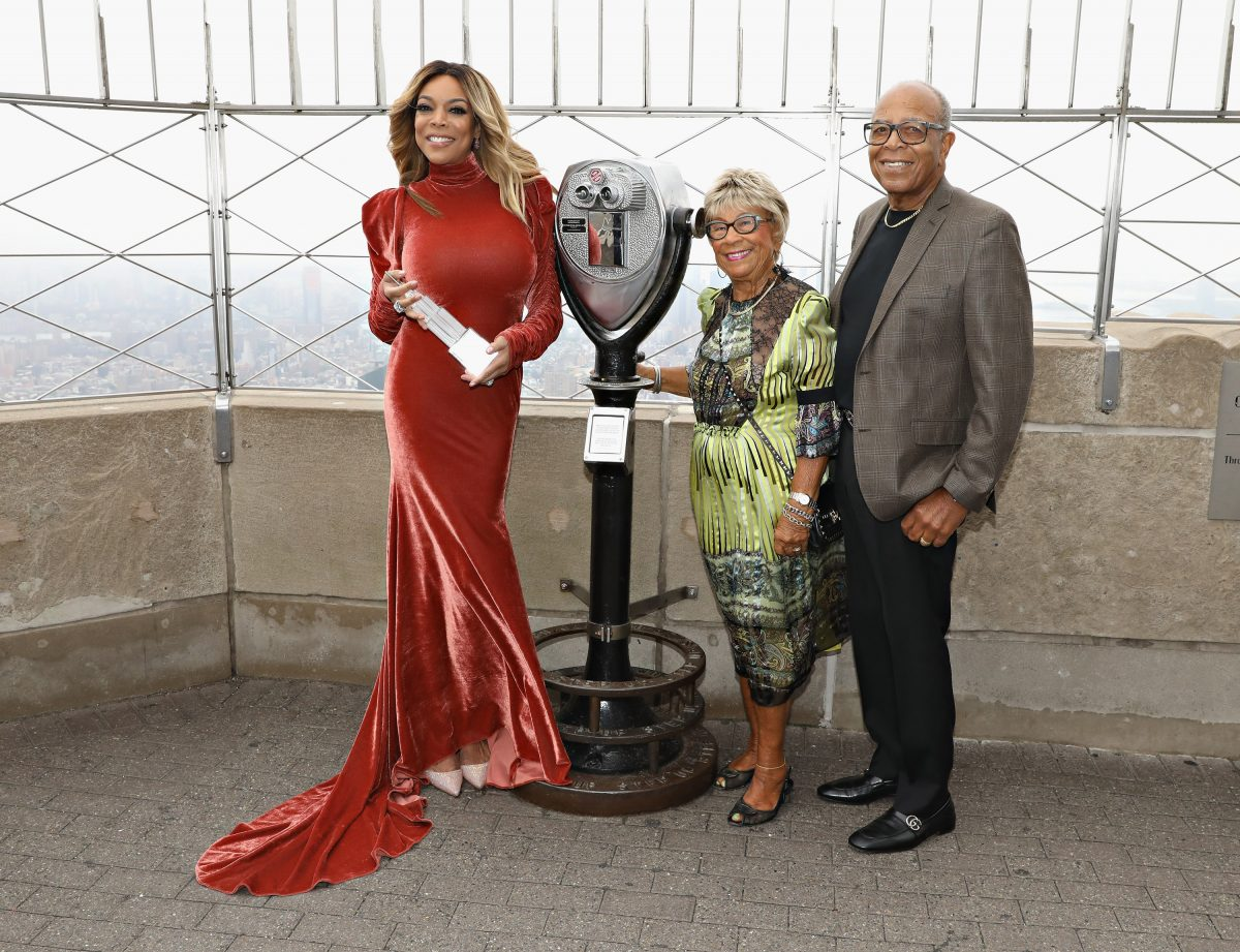 Wendy Williams and parents parents Shirley Williams and Thomas Williams Sr. pose for a photo on the observation deck after taking part in the ceremonial lighting of the Empire State Building to celebrate the The Wendy Williams Show's ninth season at The Empire State Building on September 18, 2017 in New York City.