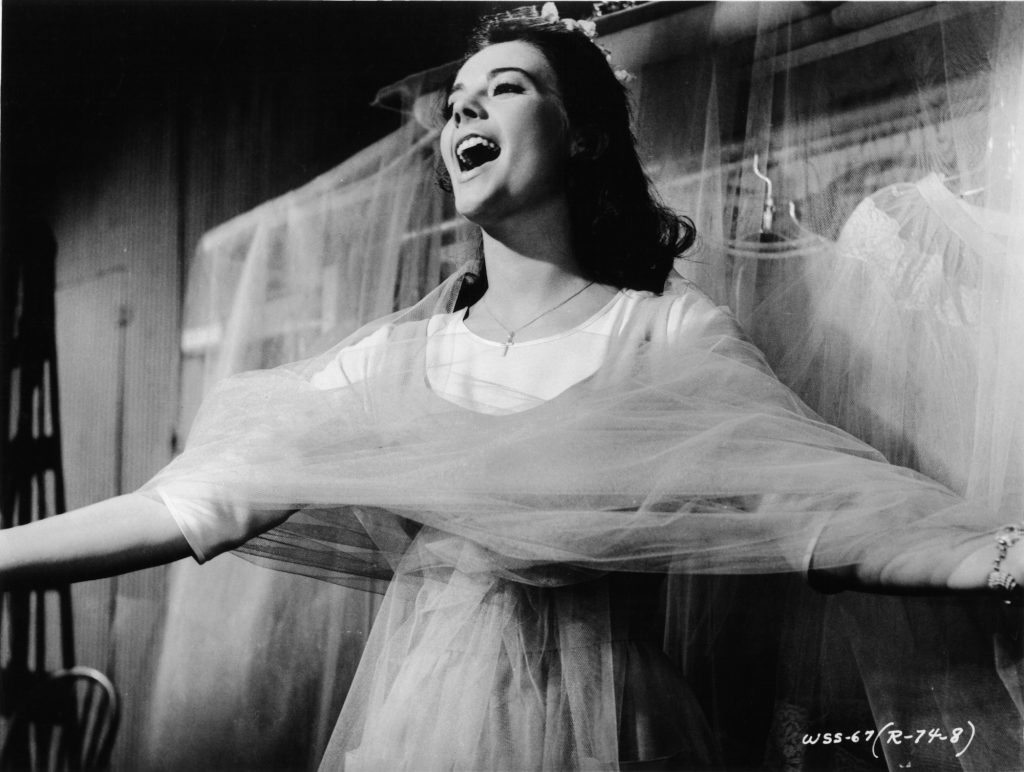 Natalie Wood wrapped in chiffon while singing in a scene from the film 'West Side Story'