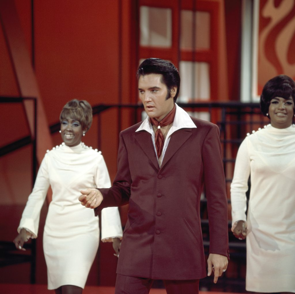 Elvis Presley and The Blossoms onstage
