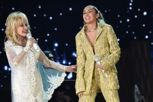 Why Miley Cyrus Calls Godmother Dolly Parton a 'Superhero': 'She Just Found This Balance of Being'