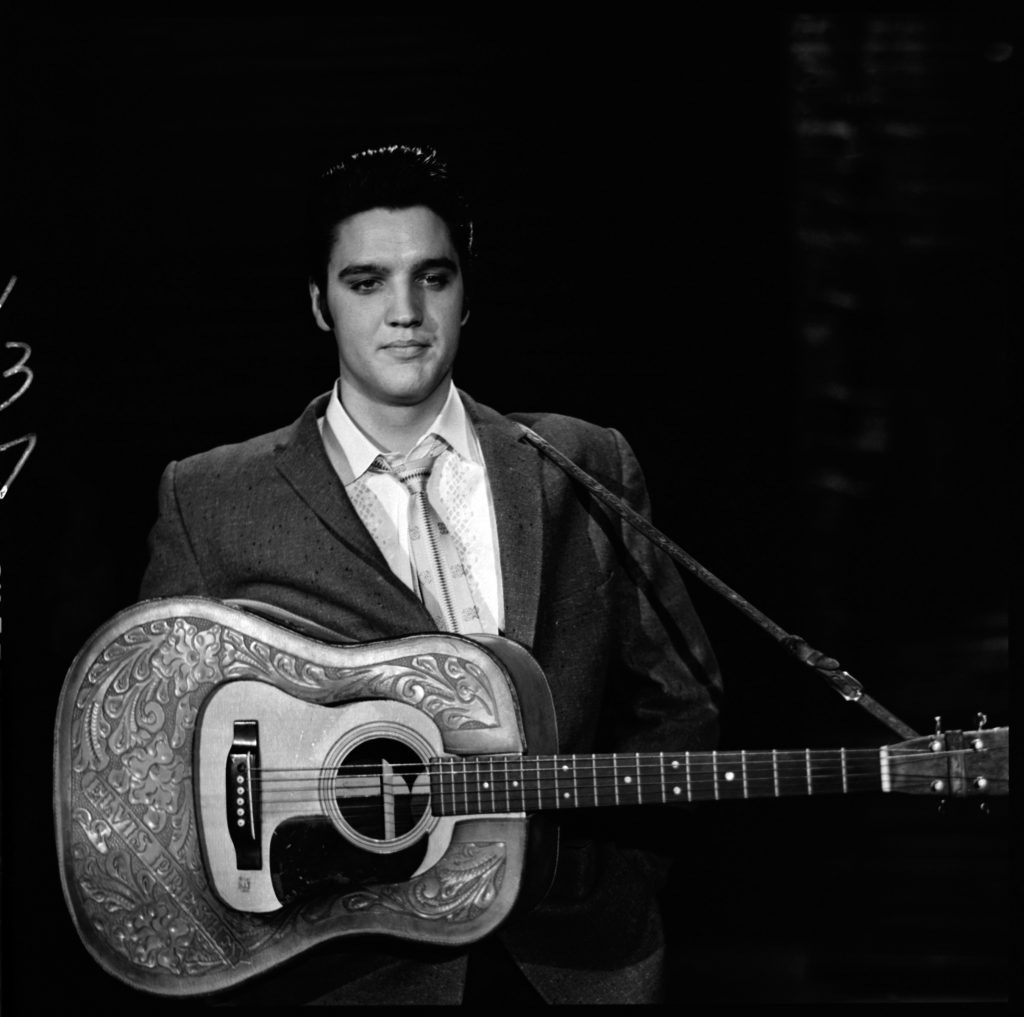 Elvis Presley with a guitar