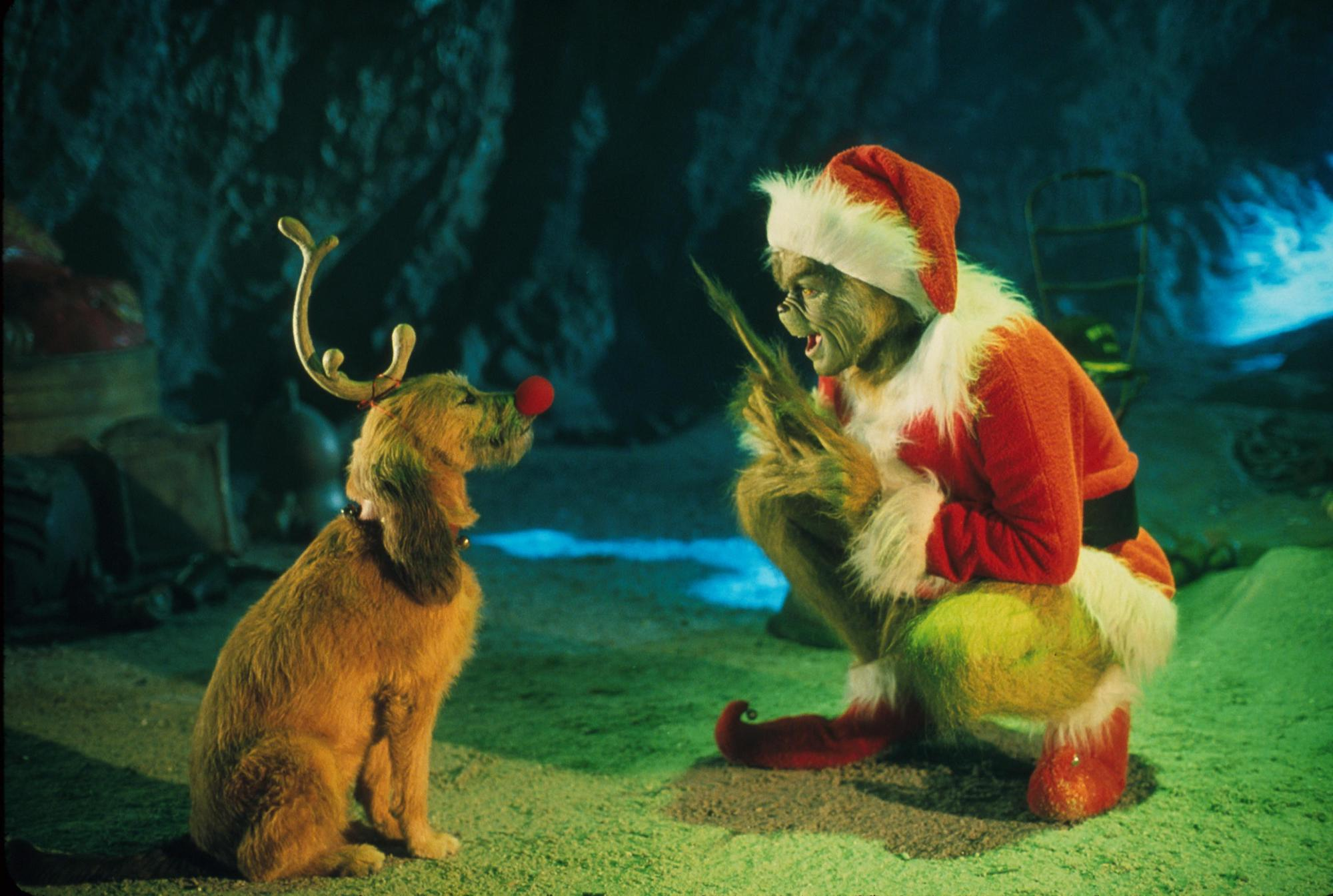 """The Grinch, Played By Jim Carrey, Conspires With His Dog Max To Deprive The Whos Of Their Favorite Holiday In 'Dr. Seuss' How The Grinch Stole Christmas,"""" Directed By Ron Howard"""