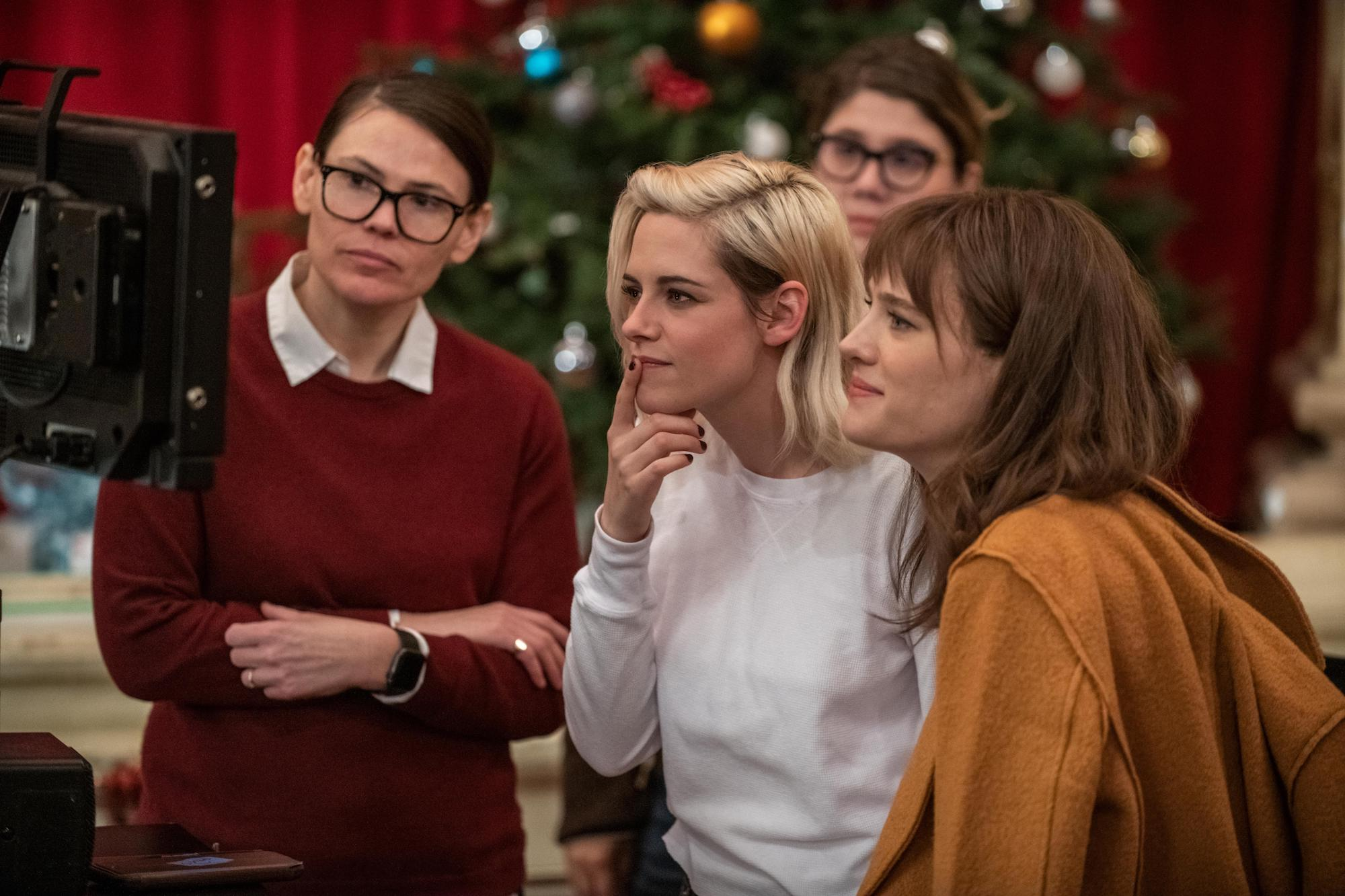 Clea DuVall (writer/director), Kristen Stewart (who plays Abby), and Mackenzie Davis (who plays Harper) on the set of 'Happiest Season'