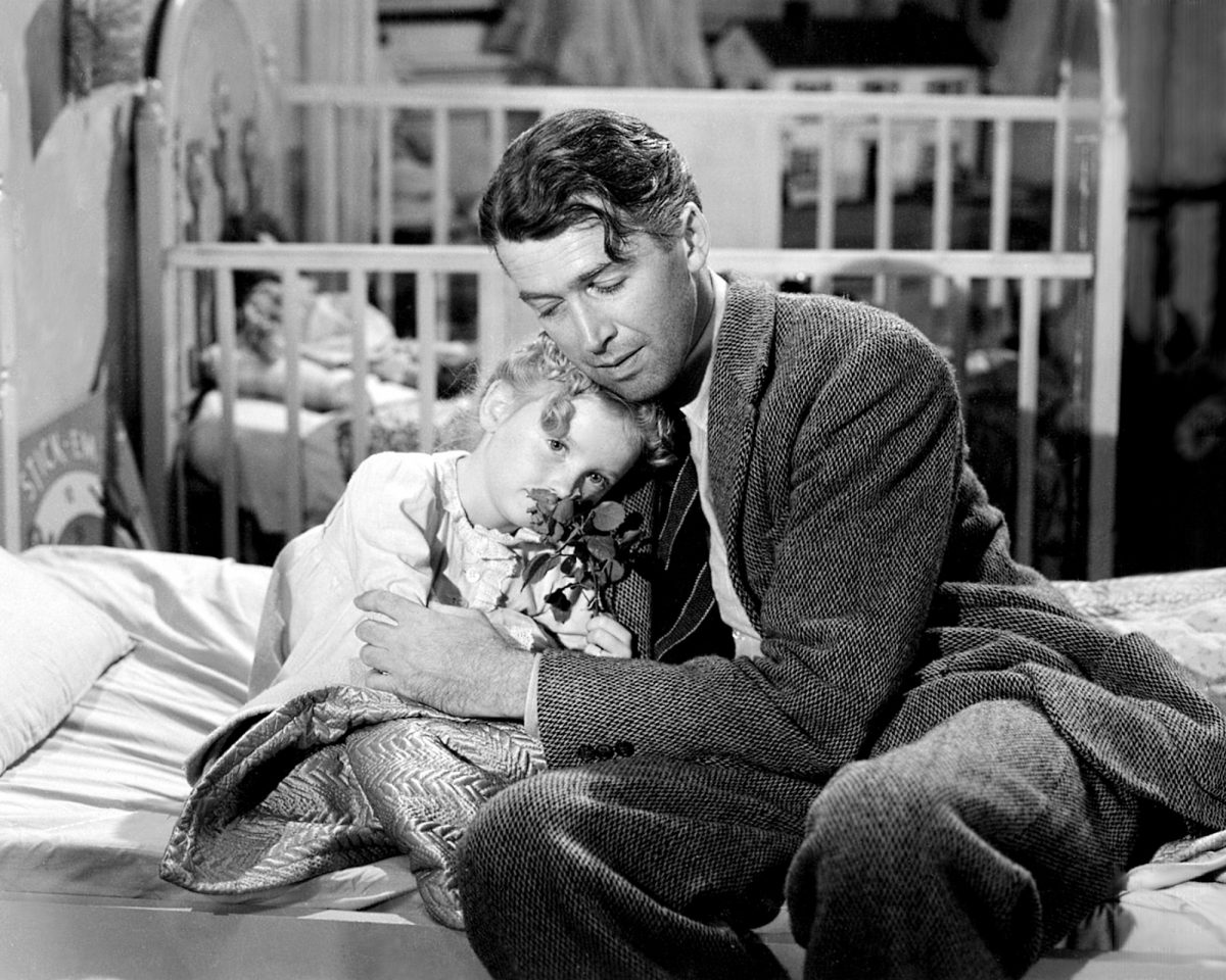 James Stewart as George Bailey and Karolyn Grimes as his daughter Zuzu in a scene from 'It's a Wonderful Life'