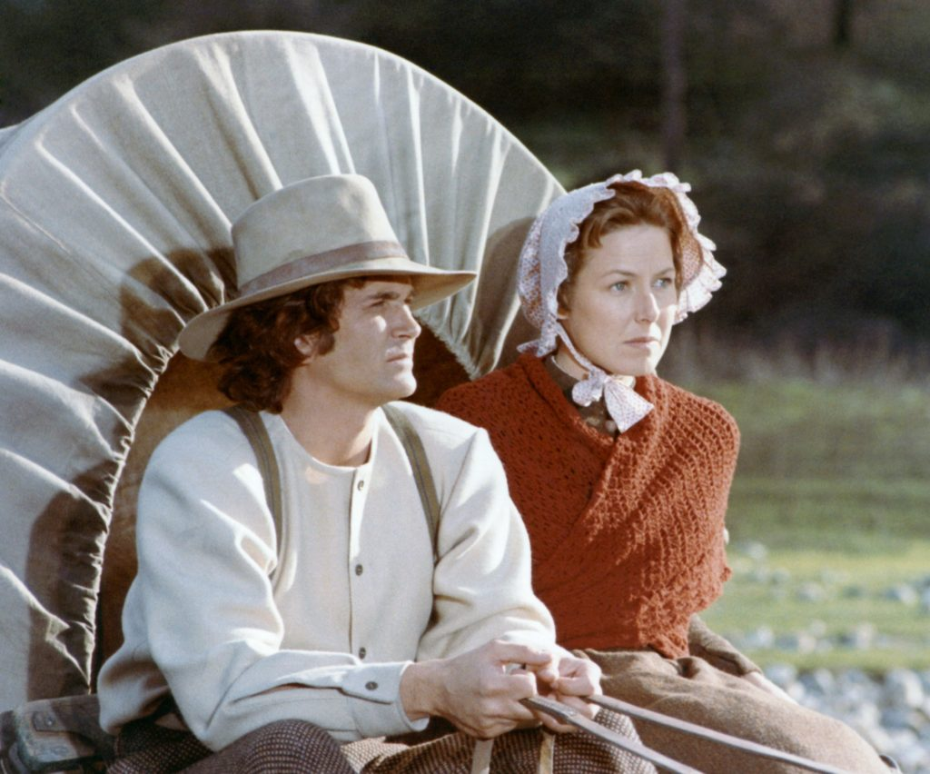 Michael Landon and Karen Grassle in a covered wagon