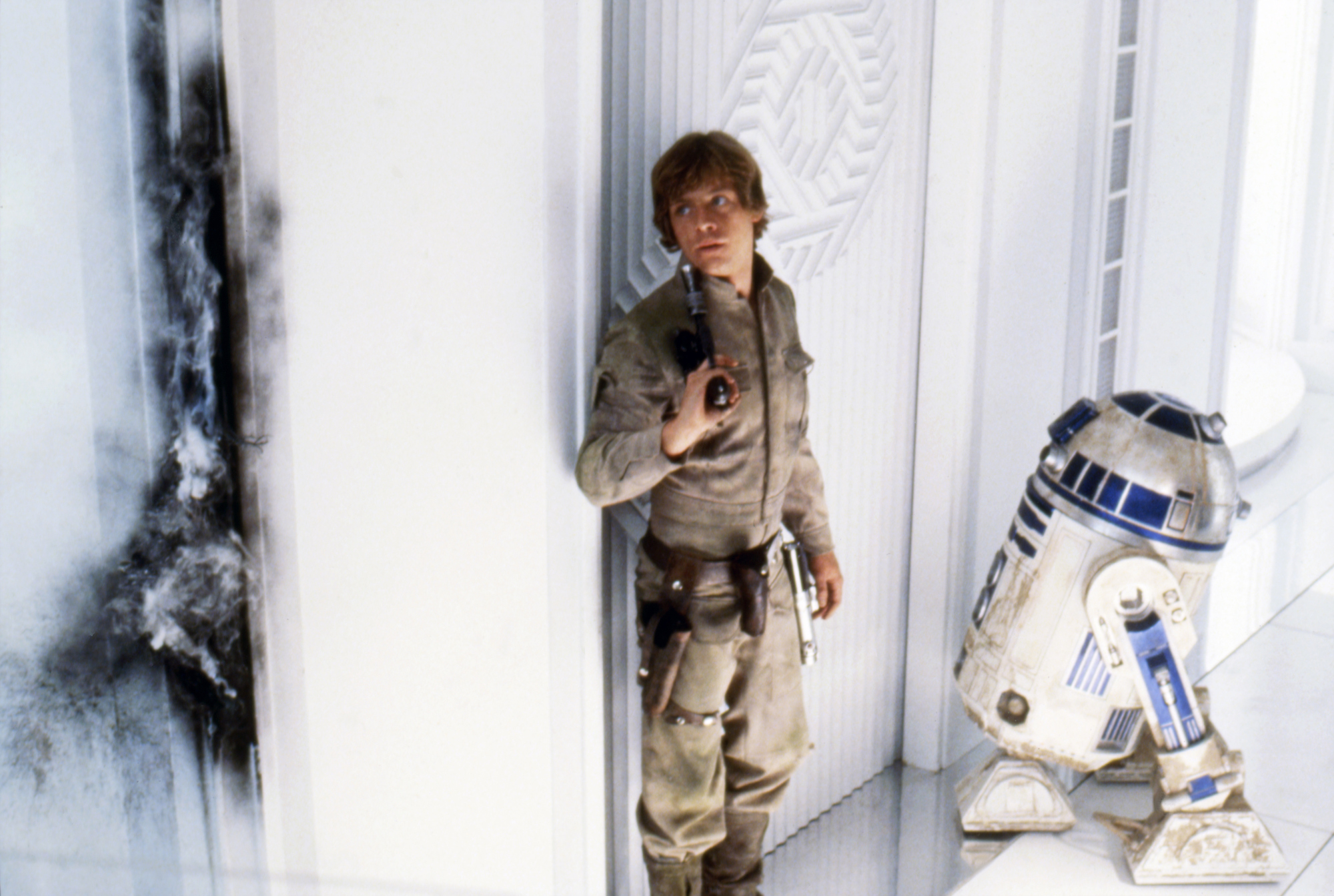 Mark Hamill (Luke Skywalker) and Kenny Baker (R2-D2) on the set of 'Star Wars: Episode V - The Empire Strikes Back' directed by Irvin Kershner