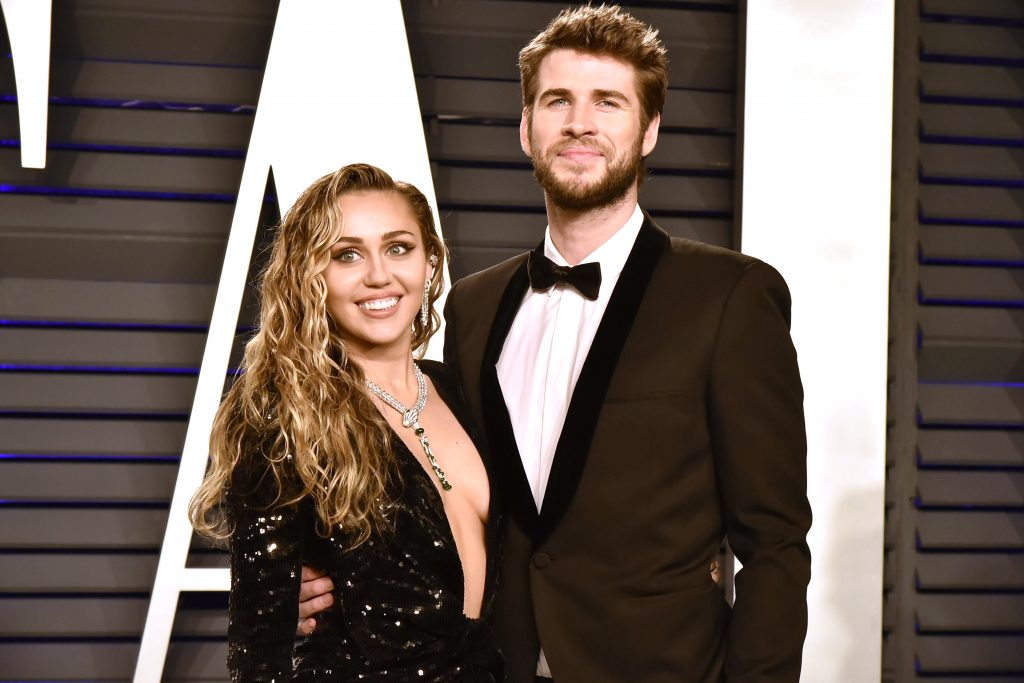 Liam Hemsworth and Miley Cyrus attend the 2019 Vanity Fair Oscar Party on February 24, 2019 in Beverly Hills, California.