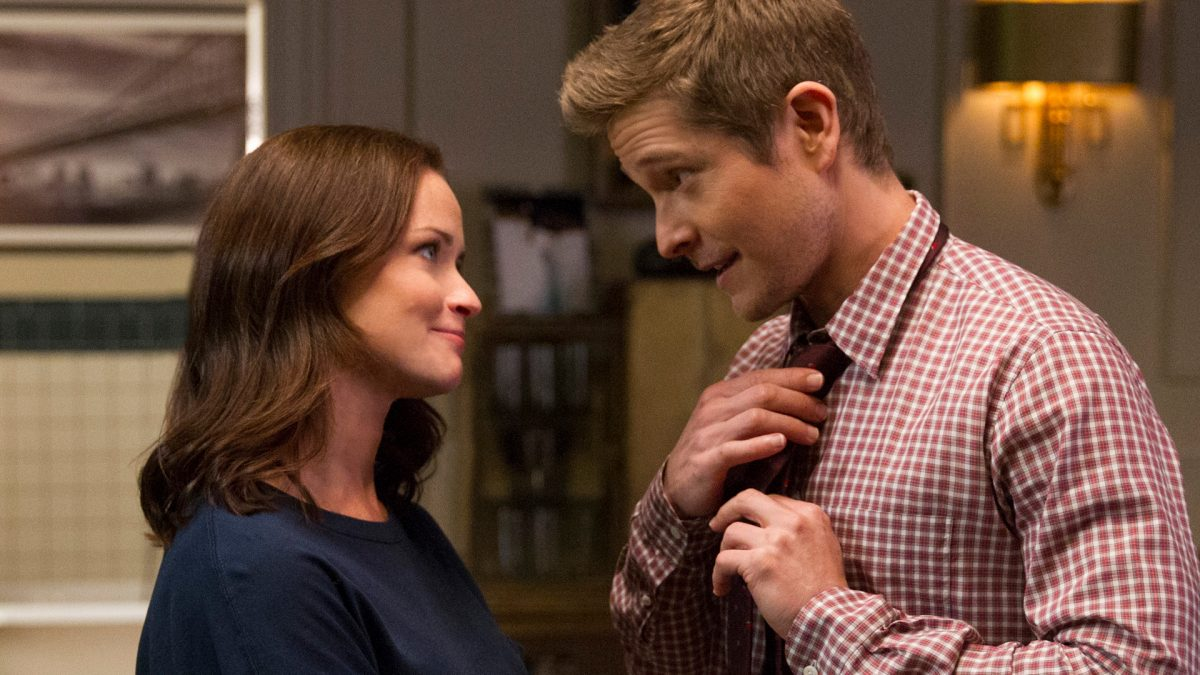 Alexis Bledel stands in front of Matt Czuchry as he adjusts his tie on 'Gilmore Girls: A Year in the Life' in 2016
