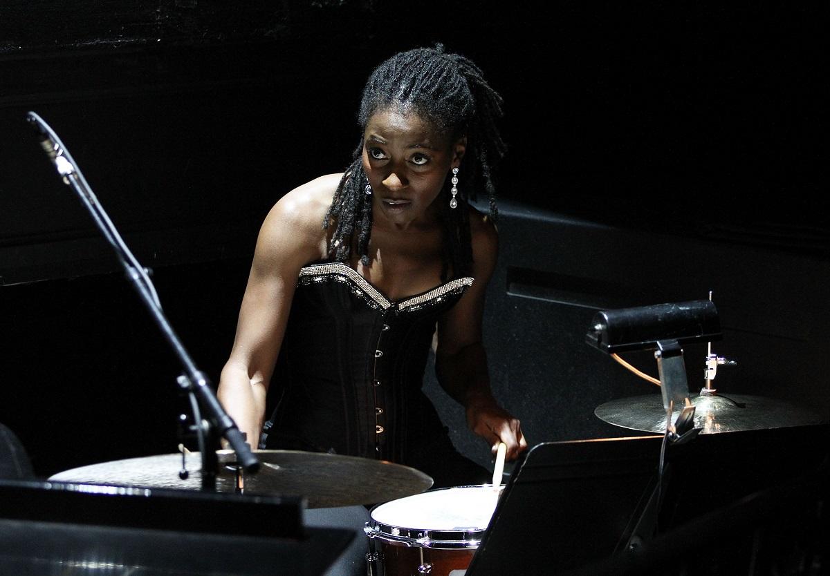 Ameenah Kaplan playing the drums in 2011
