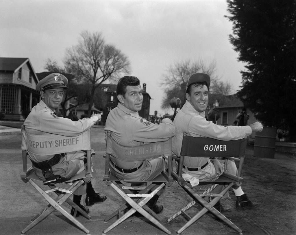 Andy Griffith as Sheriff Andy Taylor, Don Knotts as Deputy Barney Fife and Jim Nabors as Gomer Pyle during season 4.
