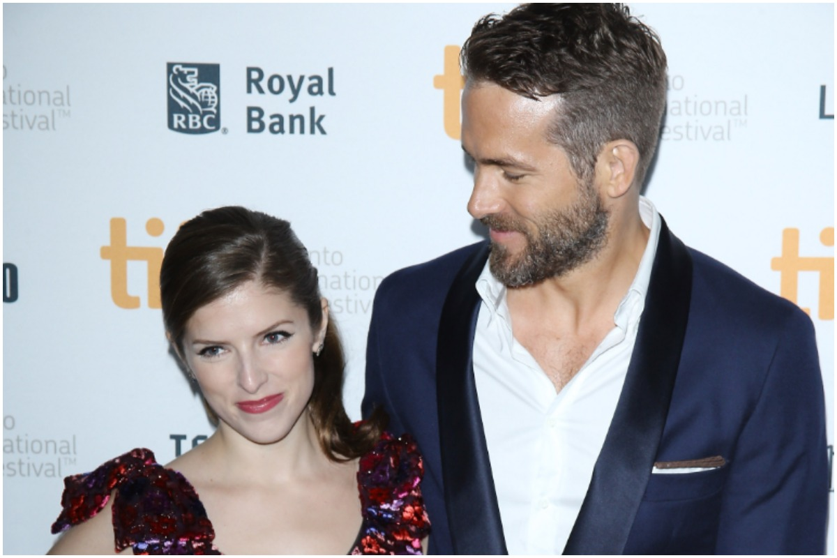 TORONTO, ON - SEPTEMBER 11: Anna Kendrick (L) and Ryan Reynolds arrive at the premiere of The Voices held during the 2014 Toronto International Film Festival - Day 8 on September 11, 2014 in Toronto, Canada.