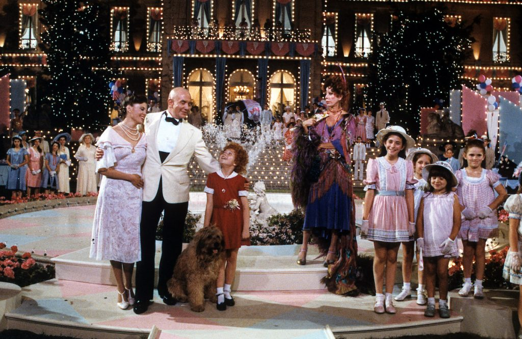 Albert Finney, Aileen Quinn, Carol Burnett and others on stage in scene from the film 'Annie', 1982   Columbia Pictures/Getty Images