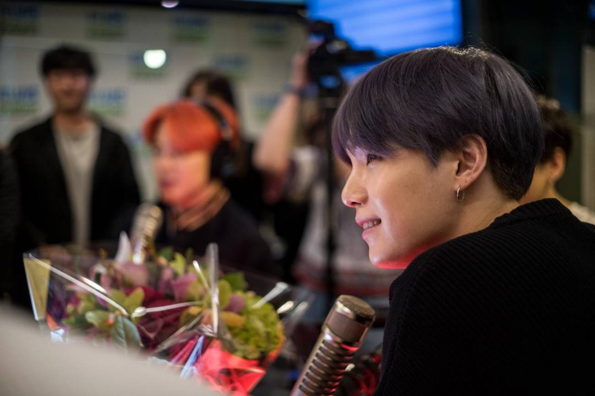 BTS Suga in front of microphone at radio station