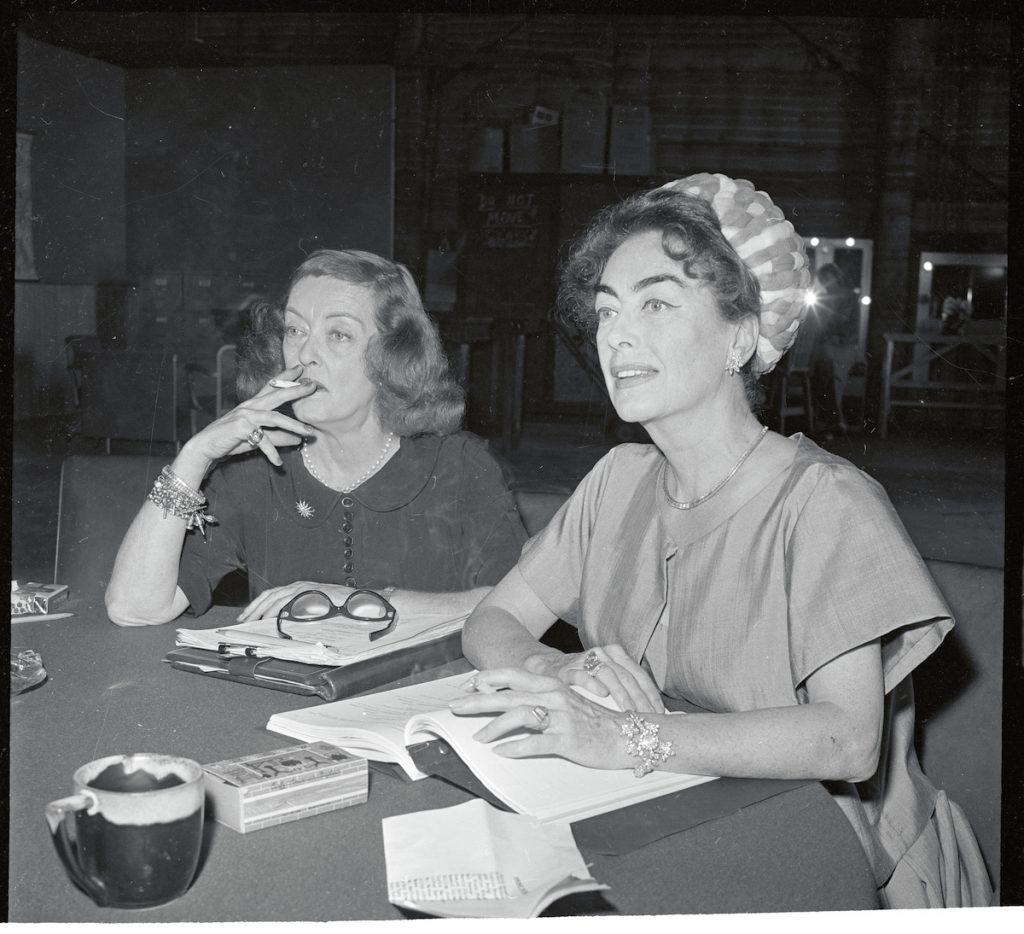 Bette Davis (L), and Joan Crawford