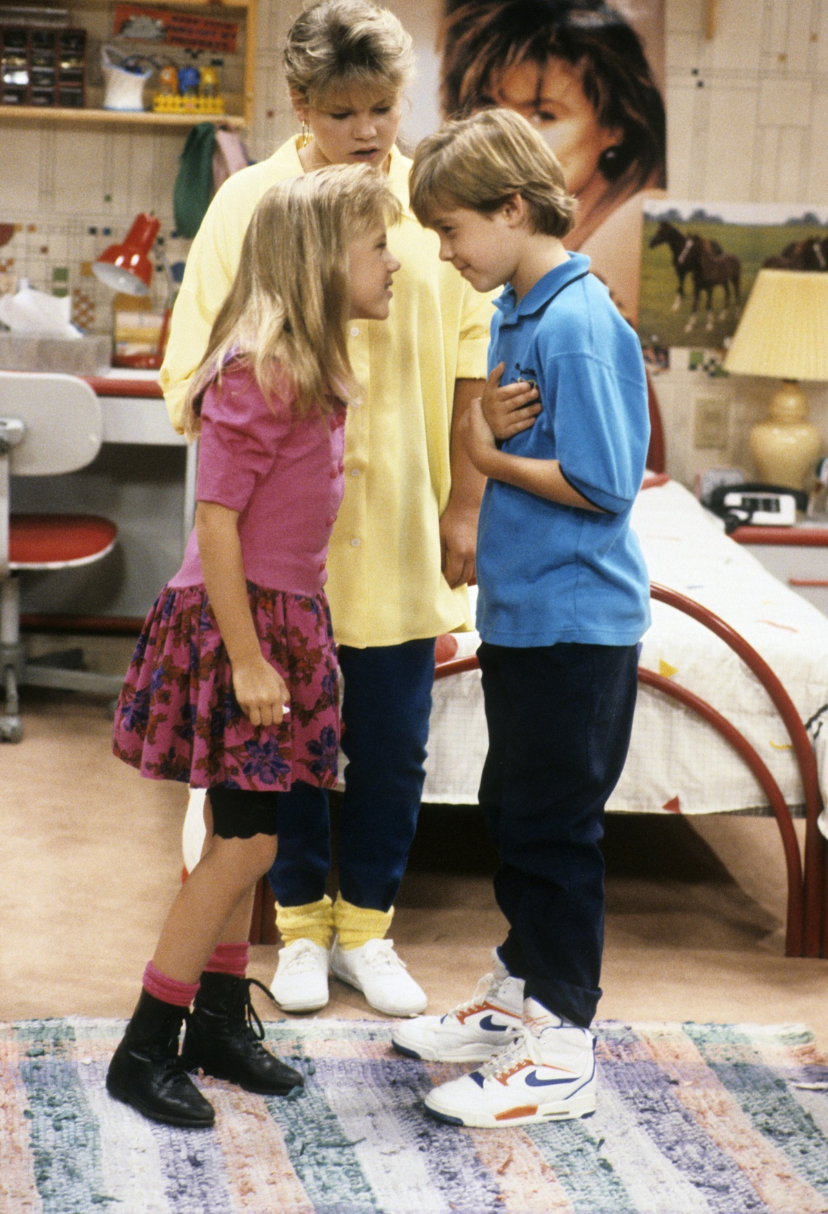Candace Cameron, Jodie Sweetin, and Jordan Christopher Michael in a scene from 'Full House'