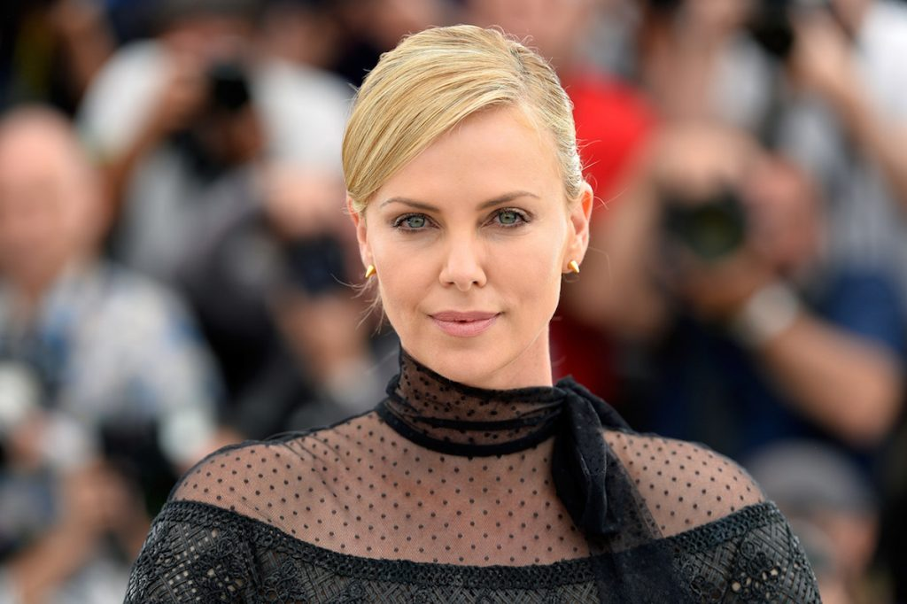 """Charlize Theron attends a photocall for """"Mad Max: Fury Road"""" during the 68th annual Cannes Film Festival on May 14, 2015 in Cannes, France."""