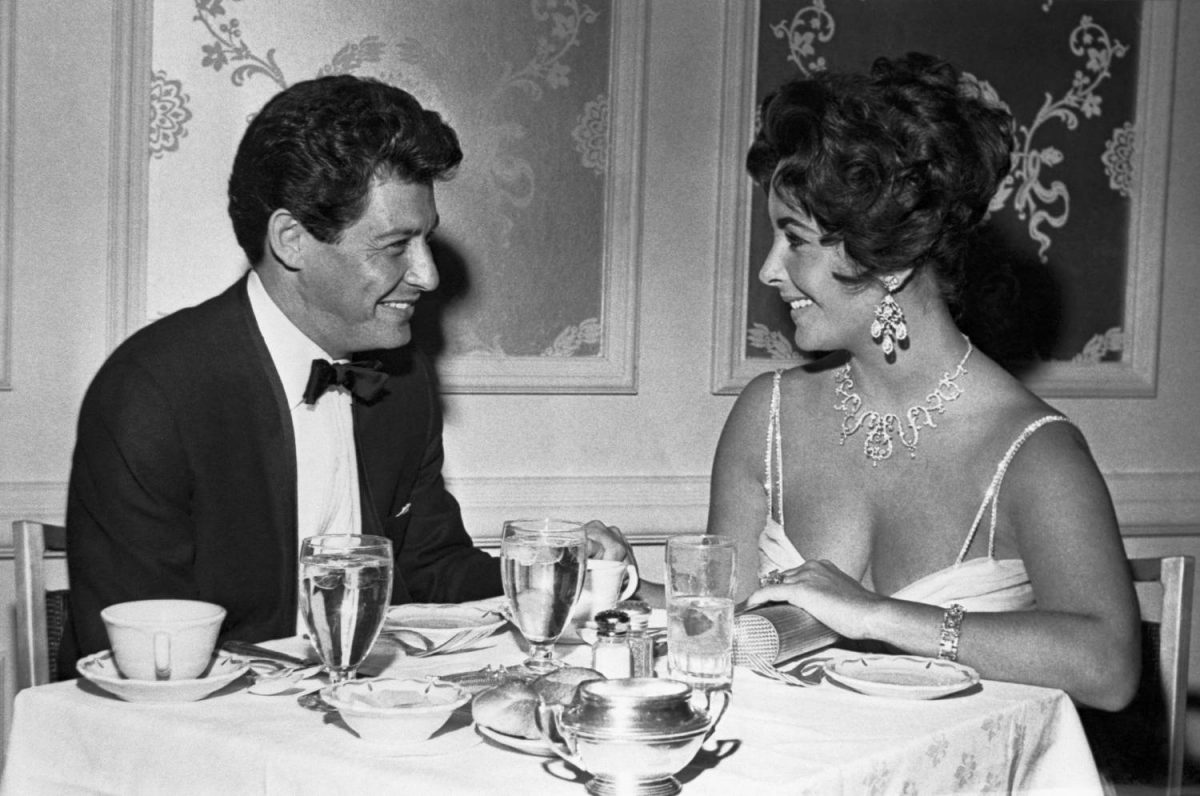 Crooner Eddie Fisher and betrothed actress Elizabeth Taylor huddle over last minute plans for their Las Vegas wedding Tuesday, to follow his expected divorce from Debbie Reynolds in Las Vegas Monday. Fisher and Miss Taylor plan to be united in a simple civil ceremony at the spacious ranch where she has been staying during his appearance at the Hotel Tropicana.