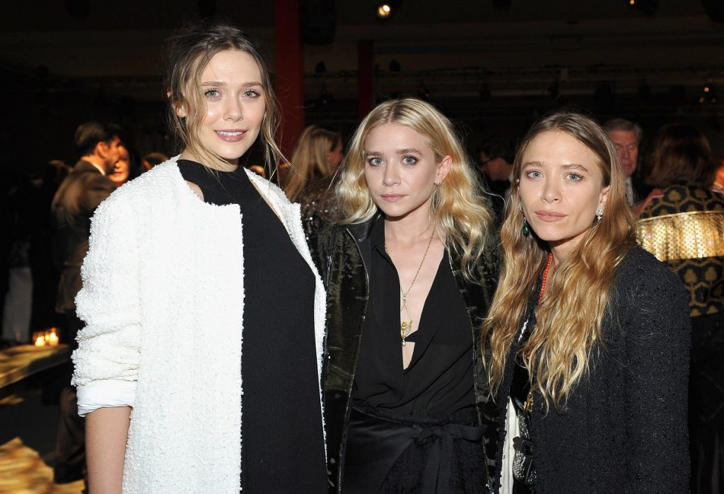sisters Elizabeth Olsen, Ashley Olsen, and Mary-Kate Olsen