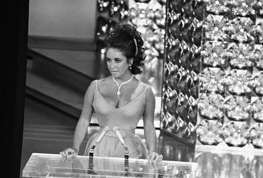"Elizabeth Taylor presents an ""Oscar"" for the best movie in the 42nd Annual Academy Awards at the Music Center"