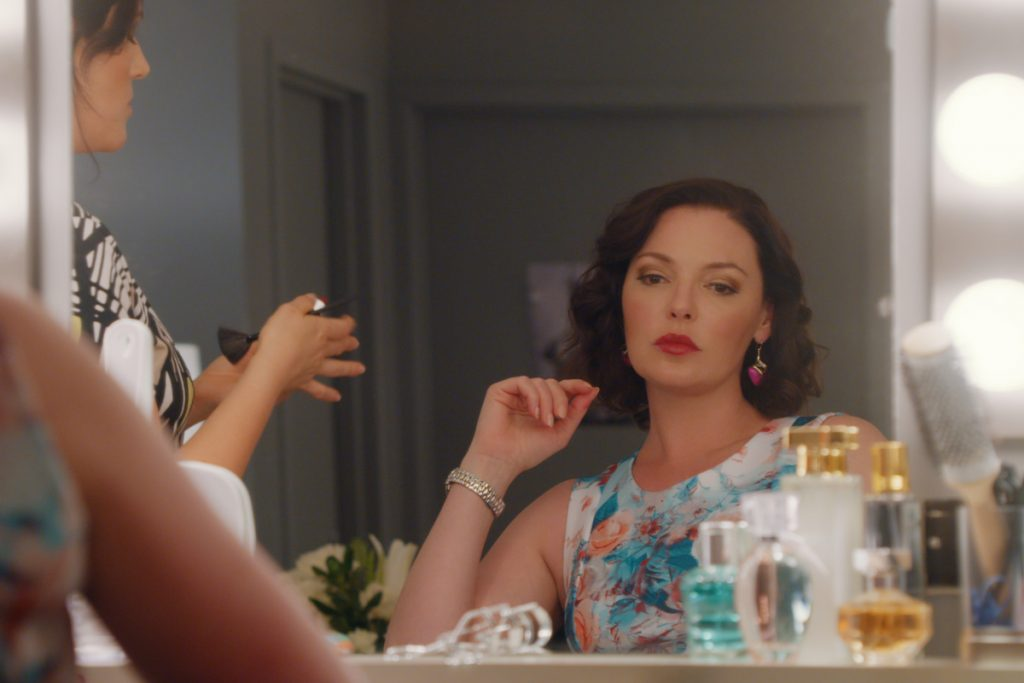 Katherine Heigl looks at herself in a mirror playing Tully on 'Firefly Lane'
