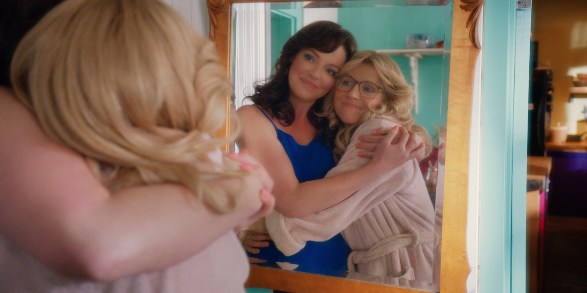 Tully and Kate embracing in front of a mirror in Firefly Lane