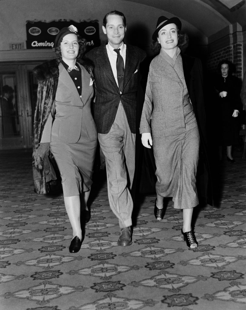 (L to R): Barbara Stanwyck, Crawford's then-husband Franchot Tone, and Joan Crawford, 1938