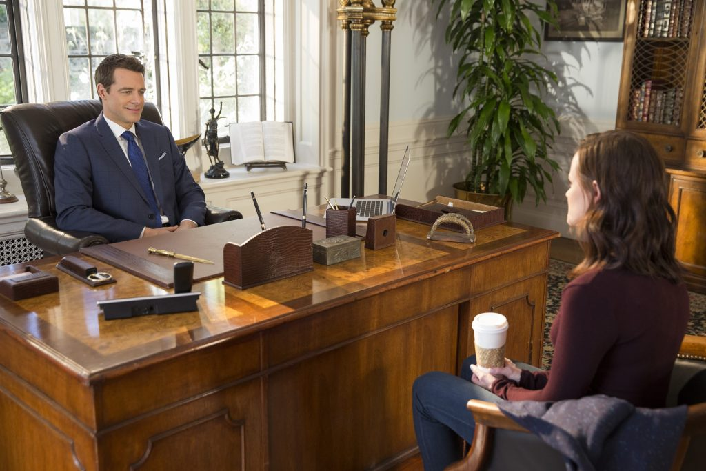 Christopher Hayden sits behind a desk and visits with Rory Gilmore in 'Gilmore Girls; A Year in the Life'