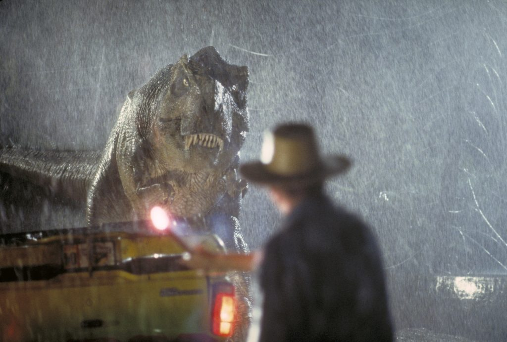 Actor Sam Neill as Dr. Alan Grant takes on a Tyrannosaurus Rex in a scene from the film 'Jurassic Park'
