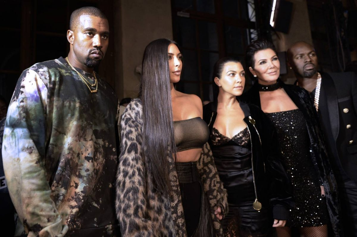 (From L) Kanye West, Kim Kardashian, Kourtney Kardashian, Kris Jenner and Corey Gamble attend the Off-white 2017 Spring/Summer ready-to-wear collection fashion show, on September 29, 2016 in Paris.