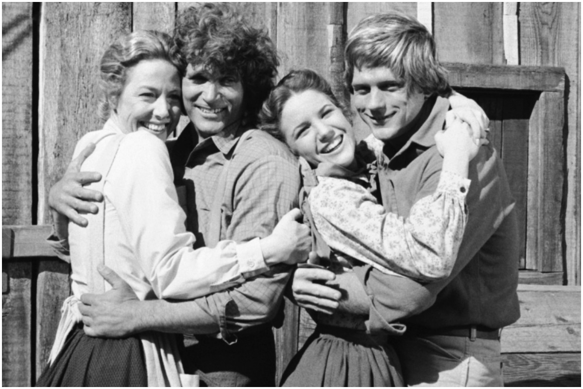 "LITTLE HOUSE ON THE PRAIRIE -- ""I Do, Again"" Episode 20 -- Aired 3/2/81 -- Pictured: (l-r) Karen Grassle as Caroline Quiner Holbrook Ingalls, Michael Landon as Charles Philip Ingalls, Melissa Gilbert as Laura Elizabeth Ingalls, Dean Butler as Almanzo James Wilder"