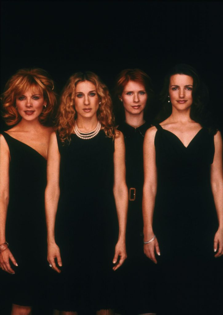 Kim Cattrall, Sarah Jessica Parker, Cynthia Nixon, and Kristin Davis pose for a portrait in an undated photo on the set of the HBO series 'Sex and the City'
