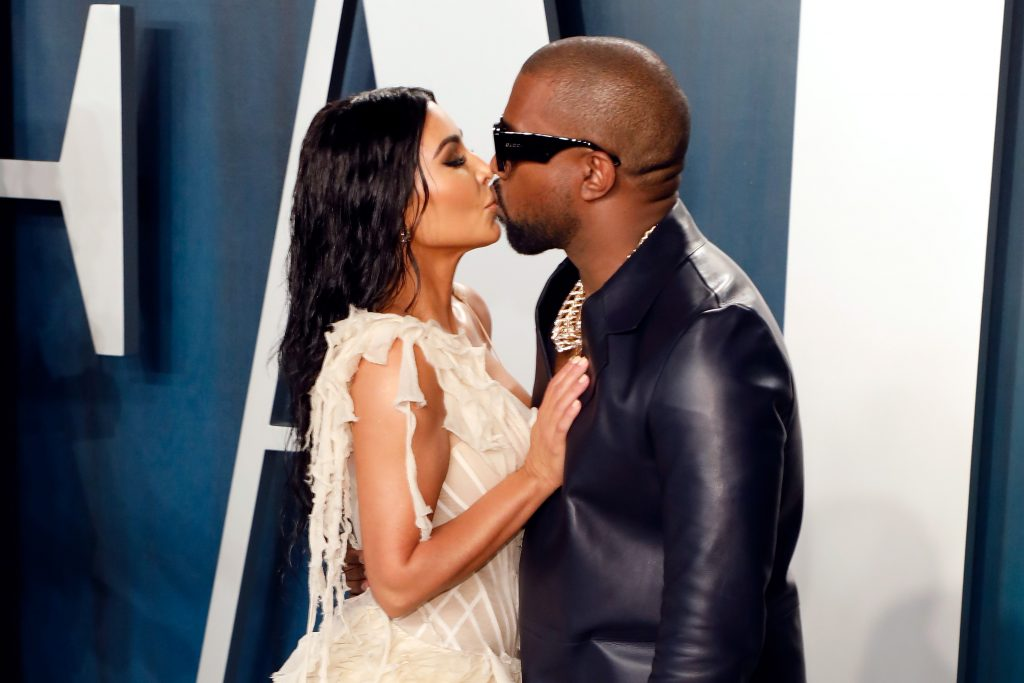 Kim Kardashian West and Kanye West kiss