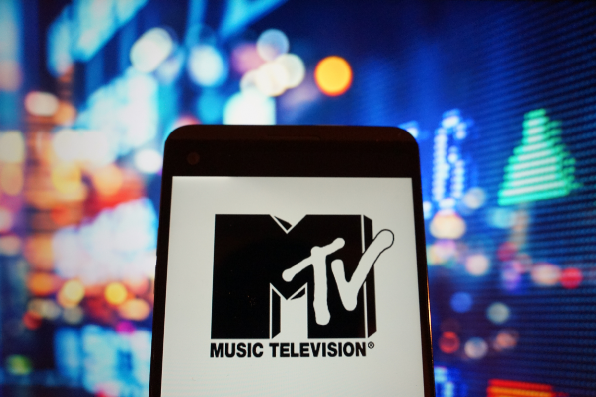 In this photo illustration, the logo of music television is seen displayed on a smartphone