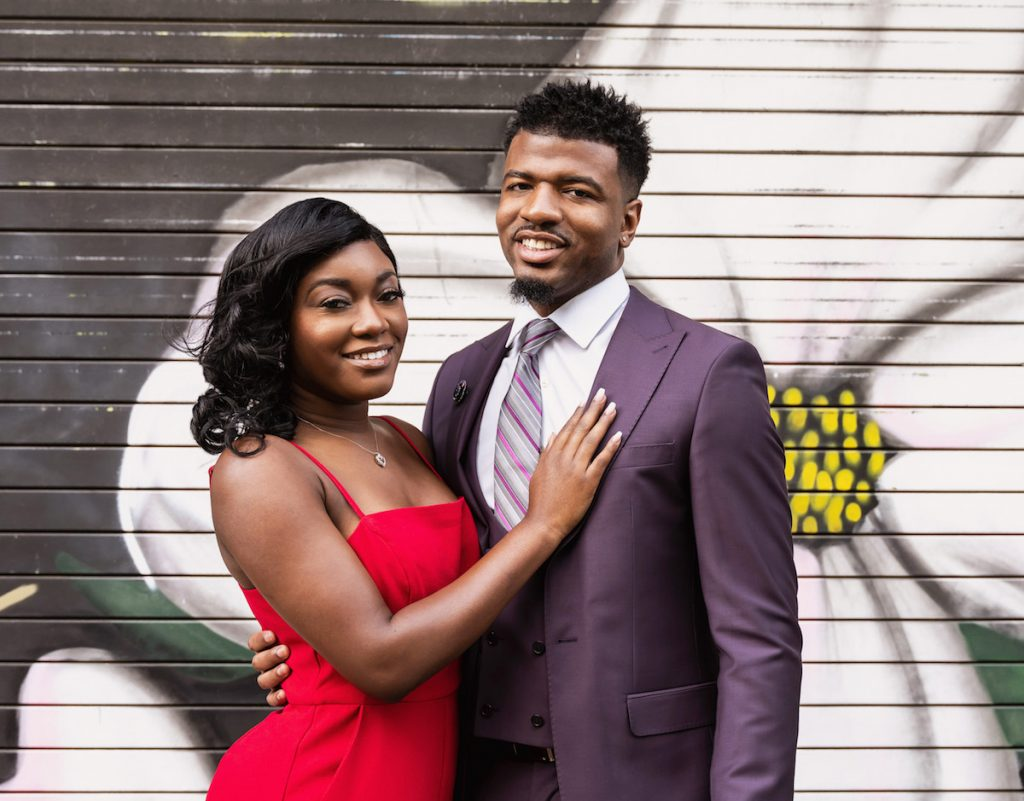 Chris poses in a suit and Paige poses in a red dress of Married at First Sight