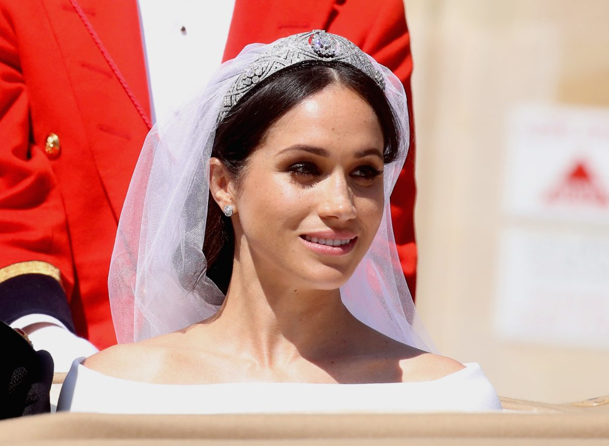 Meghan Markle smiles at her and Prince Harry's 2018 royal wedding