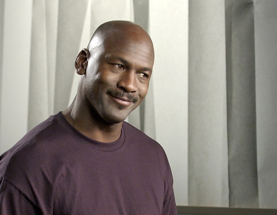 Michael Jordan smirks while filming a commercial