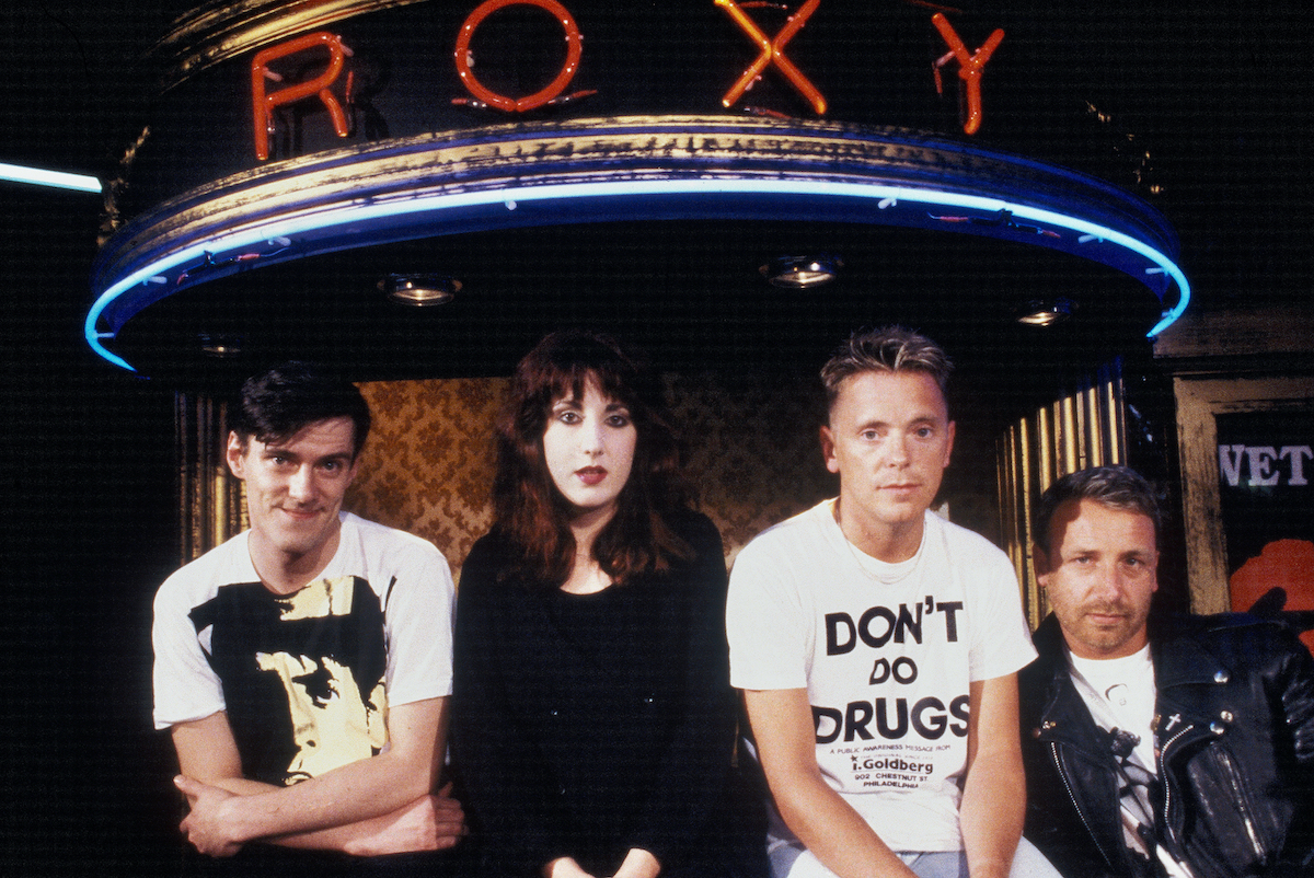 Stephen Morris, Gillian Gilbert, Bernard Sumner, and Peter Hook, of the band New Order