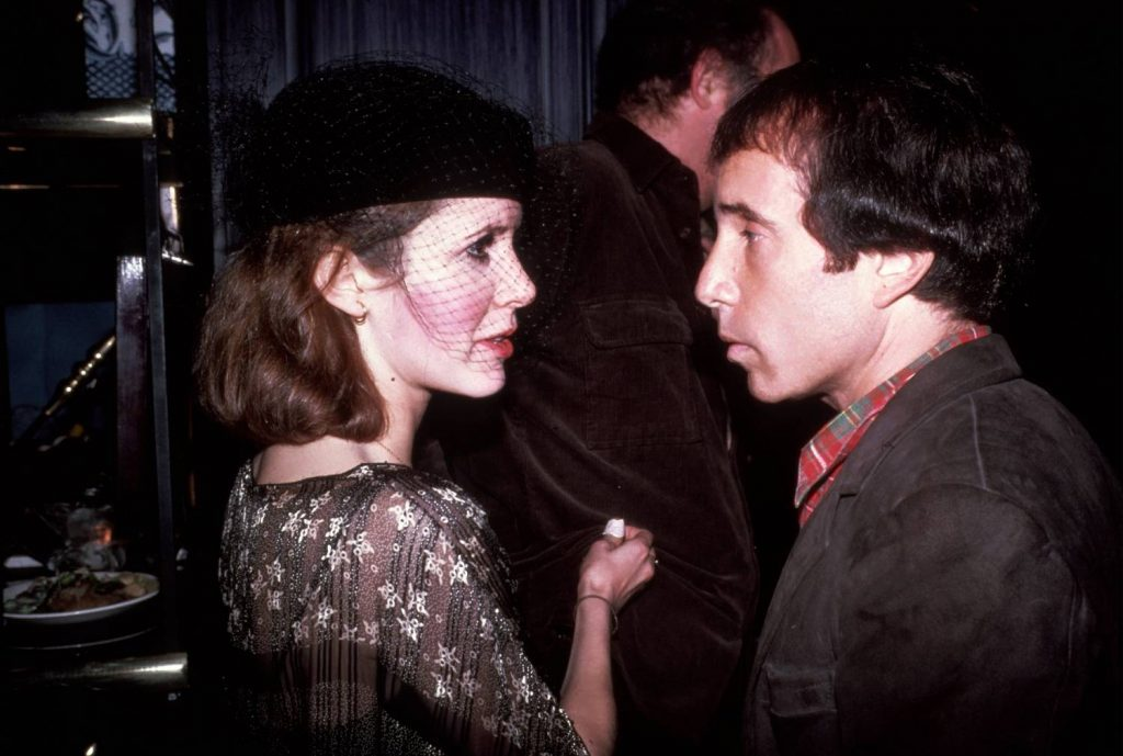 NEW YORK - CIRCA 1980: Carrie Fisher and Paul Simon circa 1980 in New York City.
