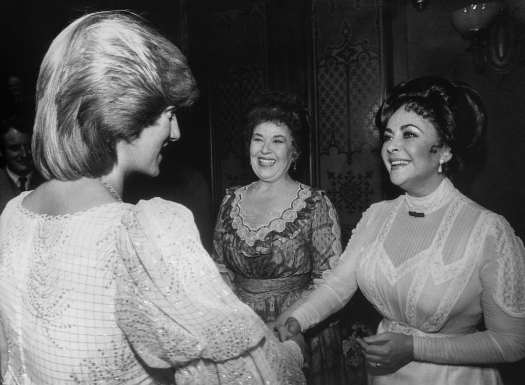 Elizabeth Taylor (right) shakes hands with Princess Diana