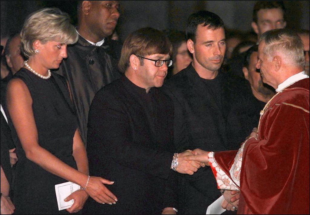Princess Diana and Sir Elton John (center) at the requiem mass for Gianni Versace in 1997