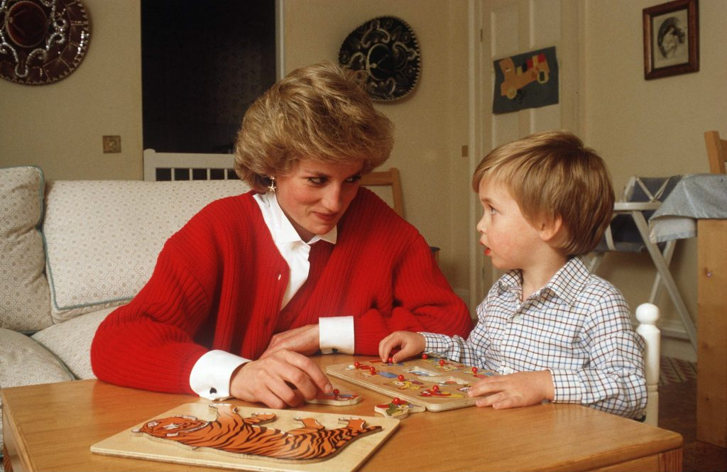 Princess Diana helping Prince William with a puzzle