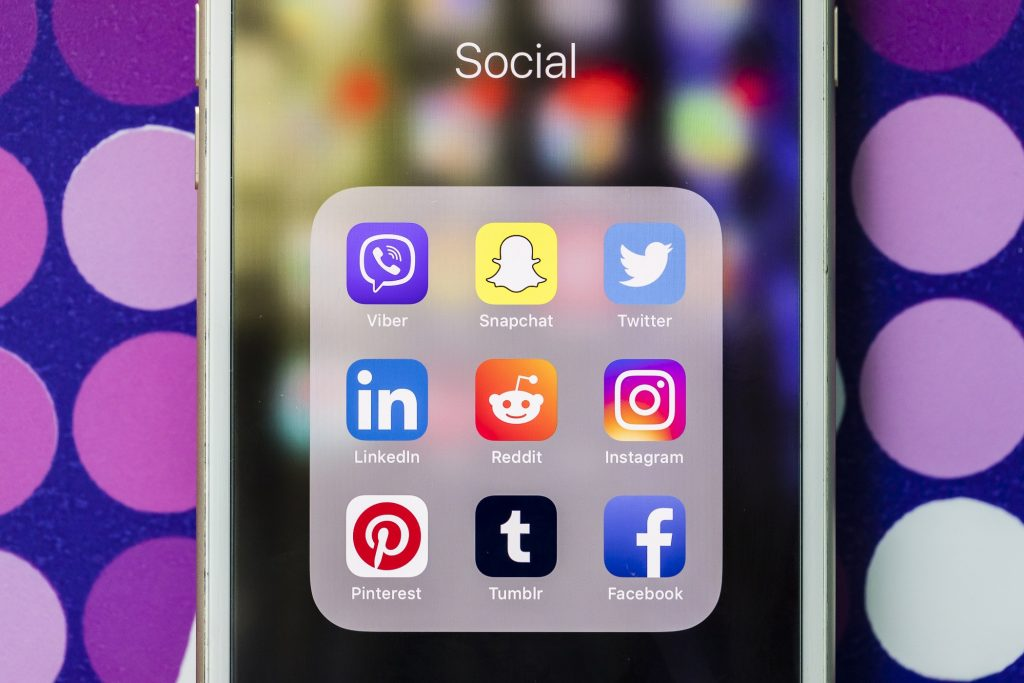 A smart phone with the icons for the social networking apps Viber, Snapchat, Twitter, Linkedin, Reddit, Instagram, Pinterest, Tumblr, and Facebook