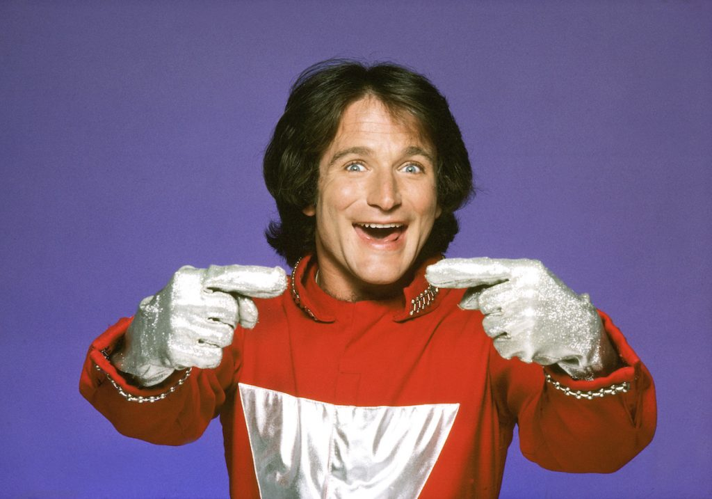 Robin Williams as Mork, an alien from the planet Ork.