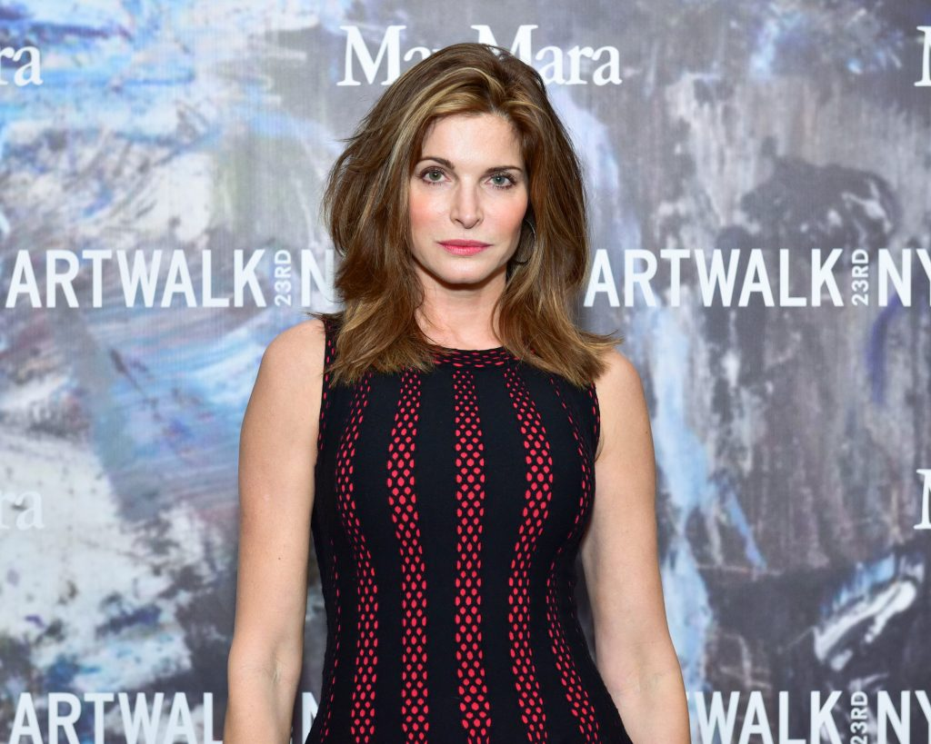 Stephanie Seymour looking at the camera in front of a patterned backdrop