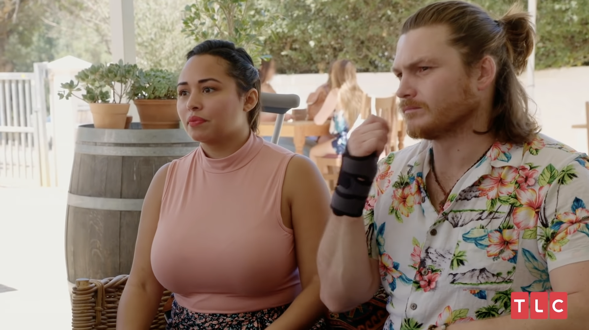 Tania Maduro and Syngin Colchester sit together on '90 Day Fiancé'