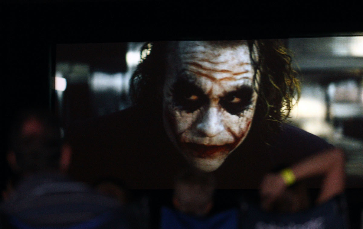 Moviegoers watch 'The Dark Knight' at a public tribute outdoor movie night to the late Heath Ledger