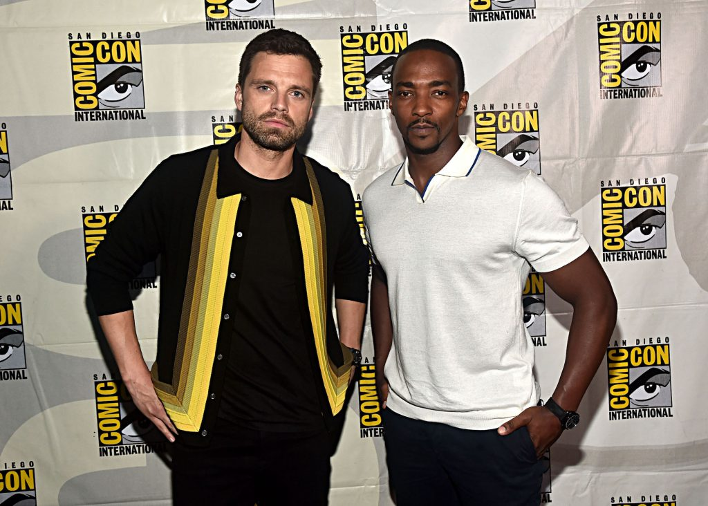 (L-R) MArvel stars Sebastian Stan and Anthony Mackie in front of a white background