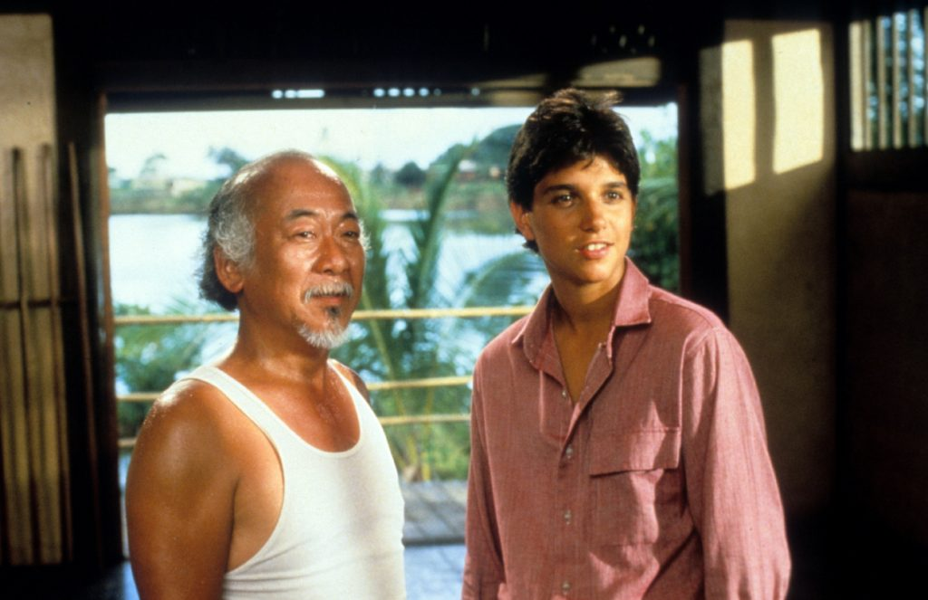 Pat Morita and Ralph Macchio in a scene from 'The Karate Kid'
